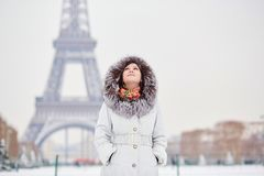 Girl enjoying rare snowy winter day in Paris Stock Images