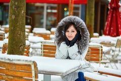 Girl enjoying rare snowy winter day in Paris Royalty Free Stock Photos