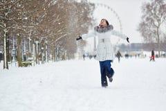 Girl enjoying rare snowy winter day in Paris Royalty Free Stock Image