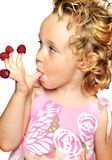 Girl enjoying  raspberry Royalty Free Stock Photos