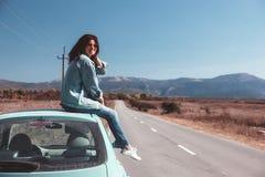 Girl enjoying road trip Stock Images