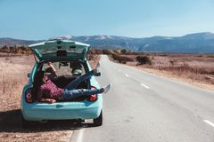 Girl enjoying road trip Royalty Free Stock Image