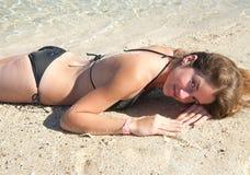 Girl enjoying the sand beach Royalty Free Stock Photos