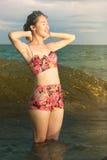 Girl enjoying seaside sunset view Royalty Free Stock Photography