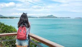 Girl enjoying on a seaside viewpoint Stock Photo