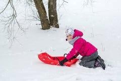 Girl enjoying a sleigh ride Stock Photos