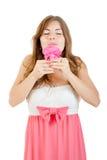 Girl enjoying the smell of rose Stock Image