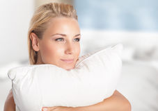 Girl enjoying soft pillow Royalty Free Stock Photo