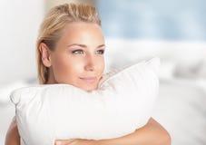 Girl enjoying soft pillow royalty free stock photo
