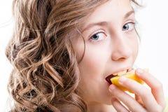 Girl enjoying sour taste of lemon. Girl eating a piece of lemon without fear of sour taste Royalty Free Stock Images