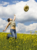 Girl enjoying spring. Girl having fun in summer rape field Stock Photos