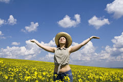 Girl enjoying spring. Girl having fun in summer rape field Stock Photography