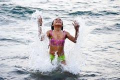 Girl Enjoying Summer. Cute Asian girl enjoying the great water during summer Royalty Free Stock Image