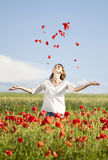 Girl enjoying summer in a poppy field Stock Photo