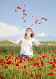 Girl enjoying summer in a poppy field Royalty Free Stock Photo