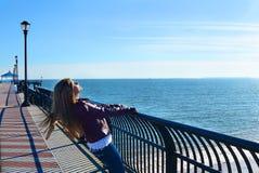Girl enjoying  sun on the beach. Stock Photography