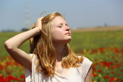 Girl enjoying sunlight Stock Images