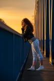 Girl enjoying the sunset Royalty Free Stock Photo