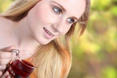 Girl enjoying tea Royalty Free Stock Photography
