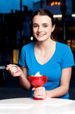 Girl enjoying tempting dessert Stock Images