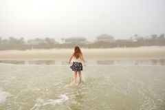 Girl enjoying time on the beach. Royalty Free Stock Photography