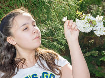 Girl Enjoying Time In Garden Observing Flowers Royalty Free Stock Photo