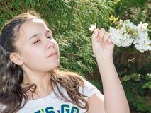 Girl Enjoying Time In Garden Observing Flowers Royalty Free Stock Photo