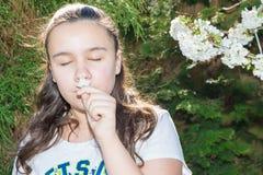 Girl Enjoying Time In Garden Observing Flowers Royalty Free Stock Image