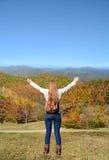 Girl enjoying time on her fall hiking  trip. Stock Photo