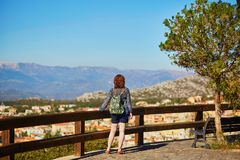 Girl enjoying view to Dorgali in Sardinia, Italy Stock Photos