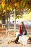 Girl enjoying warm autumn day in Paris Royalty Free Stock Photography