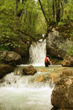 The girl is enjoying the waterfall Stock Photo