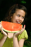 Girl enjoying watermelon Royalty Free Stock Images