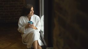Girl Enjoys Coffee near Window stock video