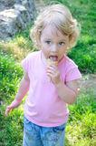 Girl enjoys an ice-cream Stock Photos