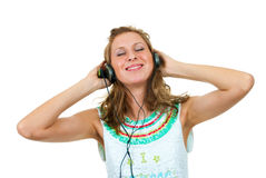 Girl enjoys listening to music Stock Photos