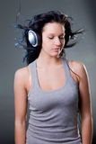 Girl enjoys music Stock Image