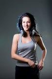 Girl enjoys music Stock Image