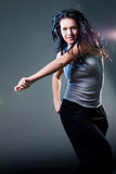 Girl enjoys music. To enjoy music, girl dance with a ear-phones royalty free stock photo