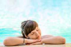 Girl enjoys the pool Royalty Free Stock Photo