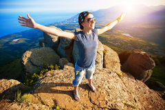 Girl  enjoys rise to the top of the mountain Royalty Free Stock Image