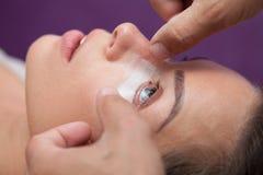 Girl enjoys salon and upgraded eyelashes Stock Image