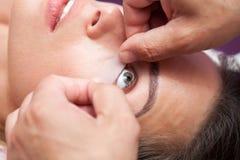 Girl enjoys salon and upgraded eyelashes Royalty Free Stock Image