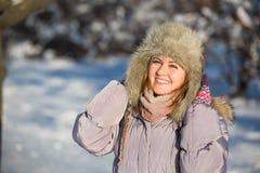 Girl enjoys the snow Stock Photo