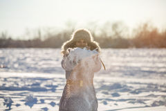 Girl enjoys the snow. Winter holidays in a fairy tale. Sun and snow. Happy girl in a fur hat Royalty Free Stock Photography