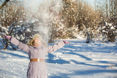 Girl enjoys the snow Stock Photo