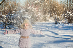 Girl enjoys the snow Royalty Free Stock Image