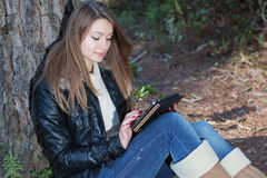 A girl enjoys the tablet. Stock Image