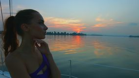Girl enjoys traveling on the yacht. Evening cruise on the river. Vacation on the yacht stock video