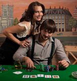 Girl enjoys winning at poker. Royalty Free Stock Image